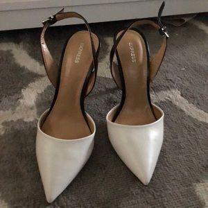 White toed black shoe